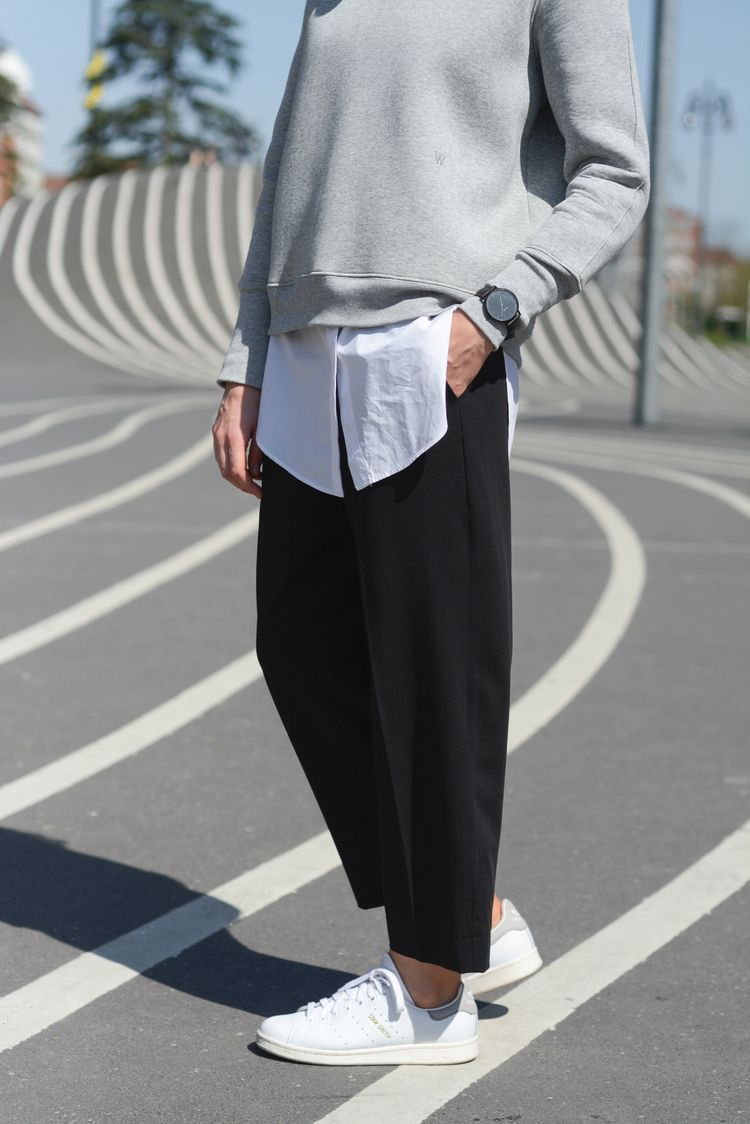 Super stylish minimalist street outfit  grey sweater, white shirt, black  loose pants and white sneakers. ffebaadec559