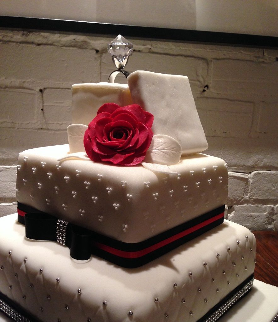 engagement cake with quilted pattern and dots with ring box cake