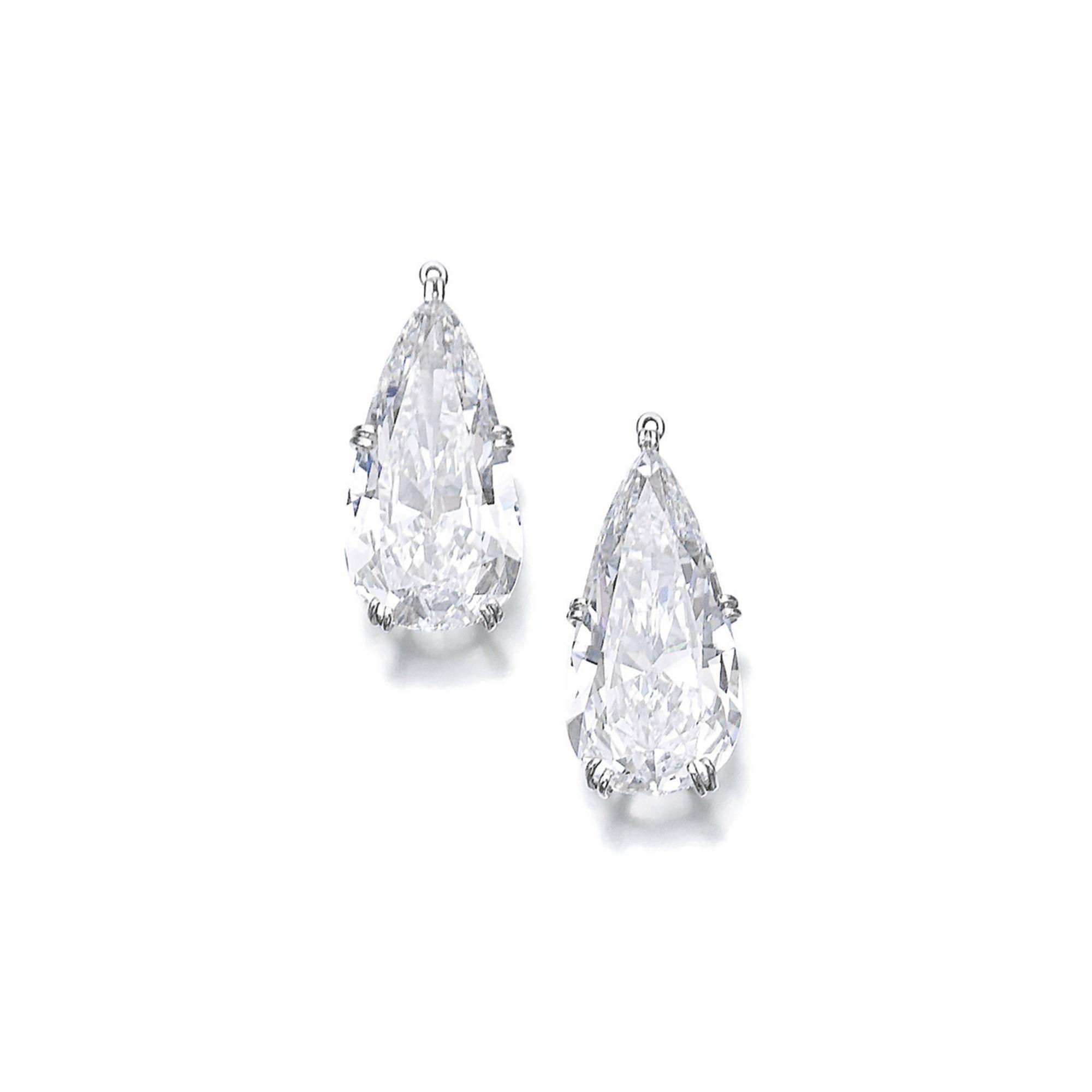 Pair of diamond pendants lot sothebyus set with pearshaped