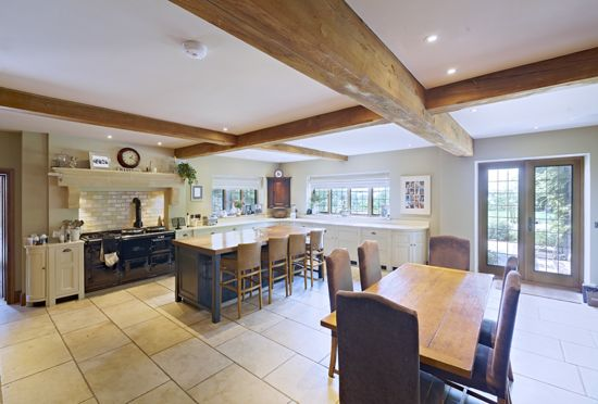 Kitchen - The classic kitchen was handmade to Viv's own design by Humphrey Munson. It features curved cabinets, and has been fitted with composite stone worktops.