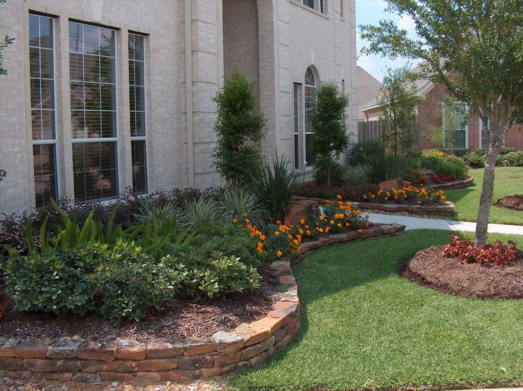 Like the rocks around the flower beds Home landscaping