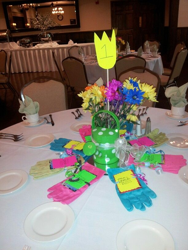 fun garden themed bridal shower party favors and cute centerpieces favors included gardening gloves and packet of seeds