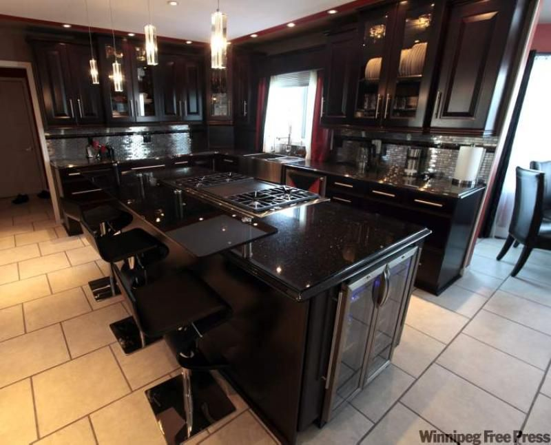 Black kitchen cabinets with black countertops kitchen for Black cabinet kitchen designs