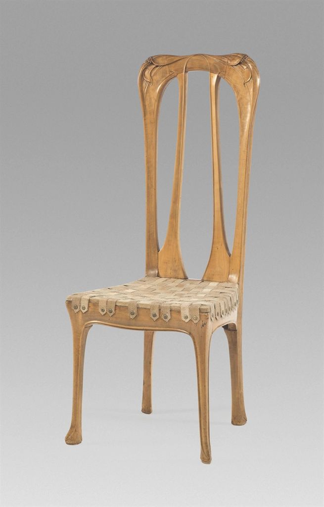 HECTOR GUIMARD (1867-1942) CHAIR, CIRCA 1905 pearwood, with leather lattice seat, finely carved with whiplash and stylised foliate motifs 46 in. (117 cm.) high
