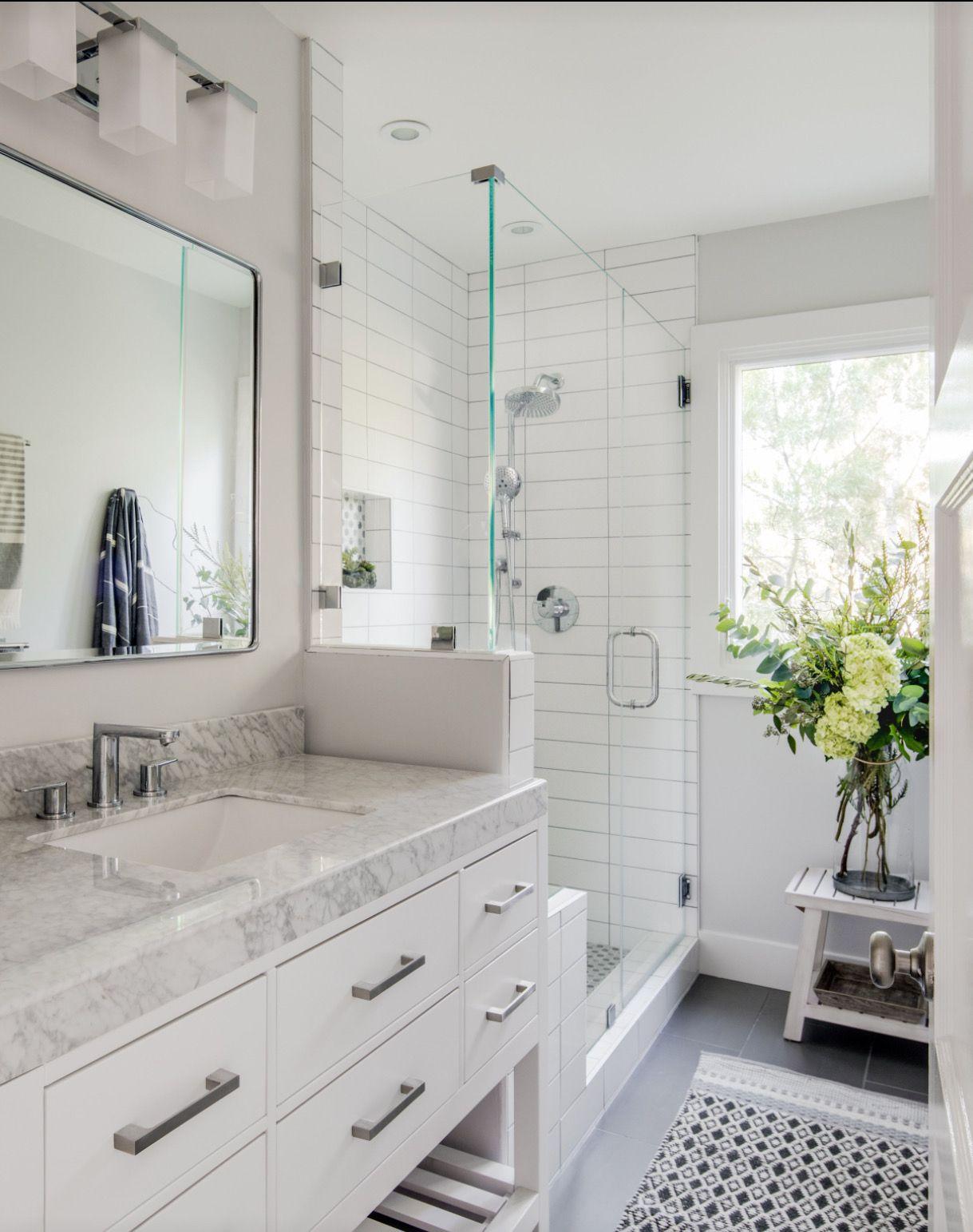 Modern white bathroom, marble, white vanity, tile, niche, penny tile ...