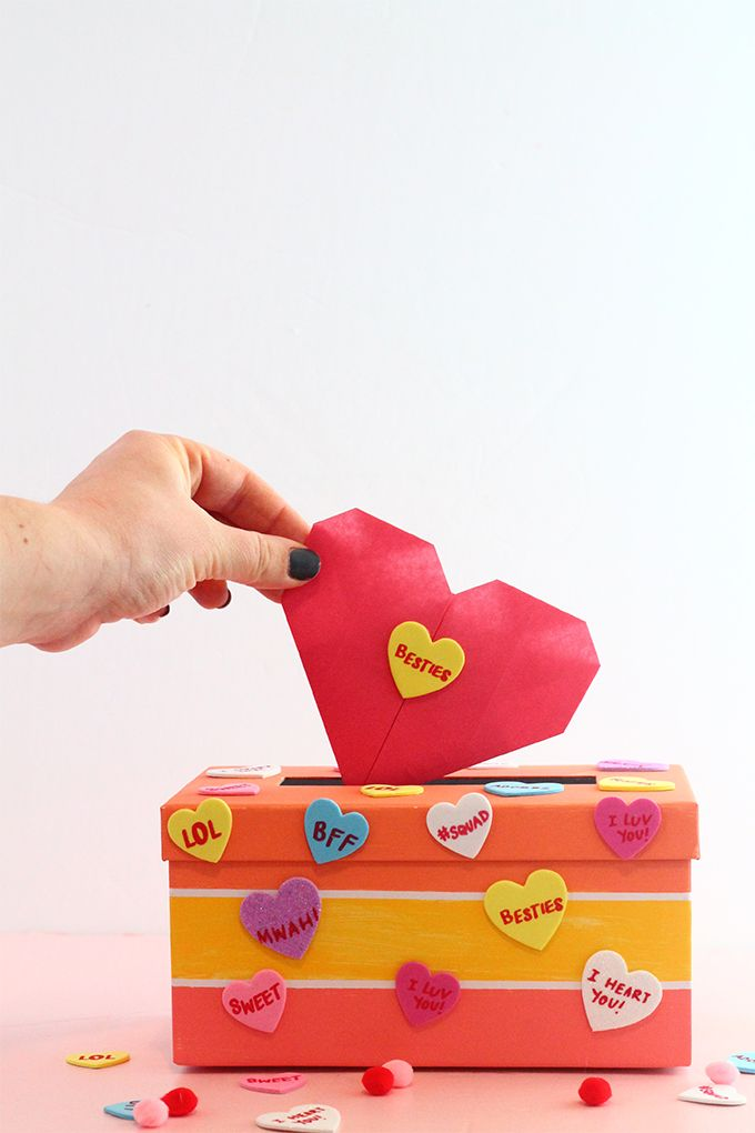 Whip up this DIY Valentine's Day Mailbox for all your goodies, and watch the video to learn how to make these easy Origami Heart Valentines to give out to your gals! | Squirrelly Minds - #valentines #origami #mailbox #conversationhearts #galentines