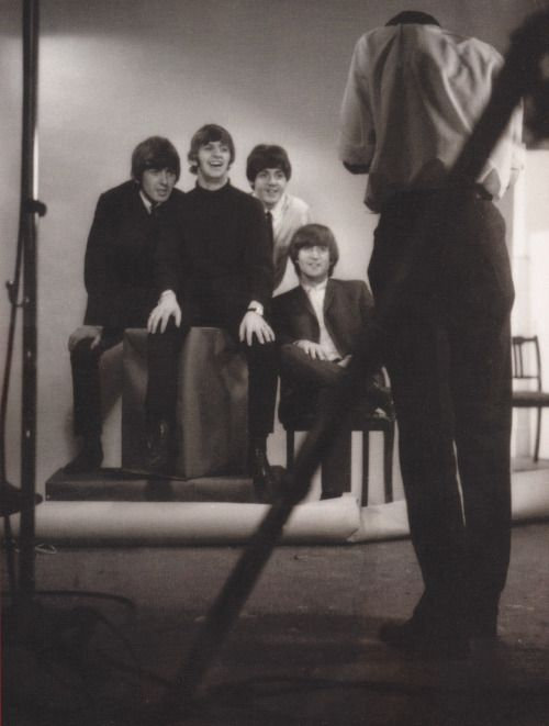 THE BEATLES POSING FOR A PHOTO...