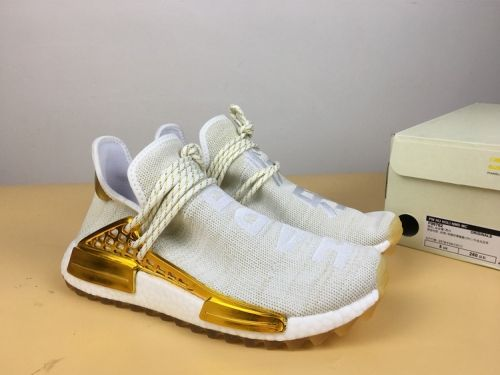 9d796f9cf0634 How To Buy Pharrell x adidas NMD Hu China Exclusive Happy Gold -  Mysecretshoes