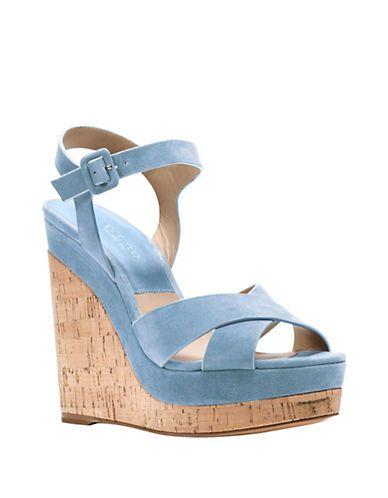 85f1b89627d5  ul  li Vintage-inspired platform sandals with leather cross-straps  li  li  Cork heel