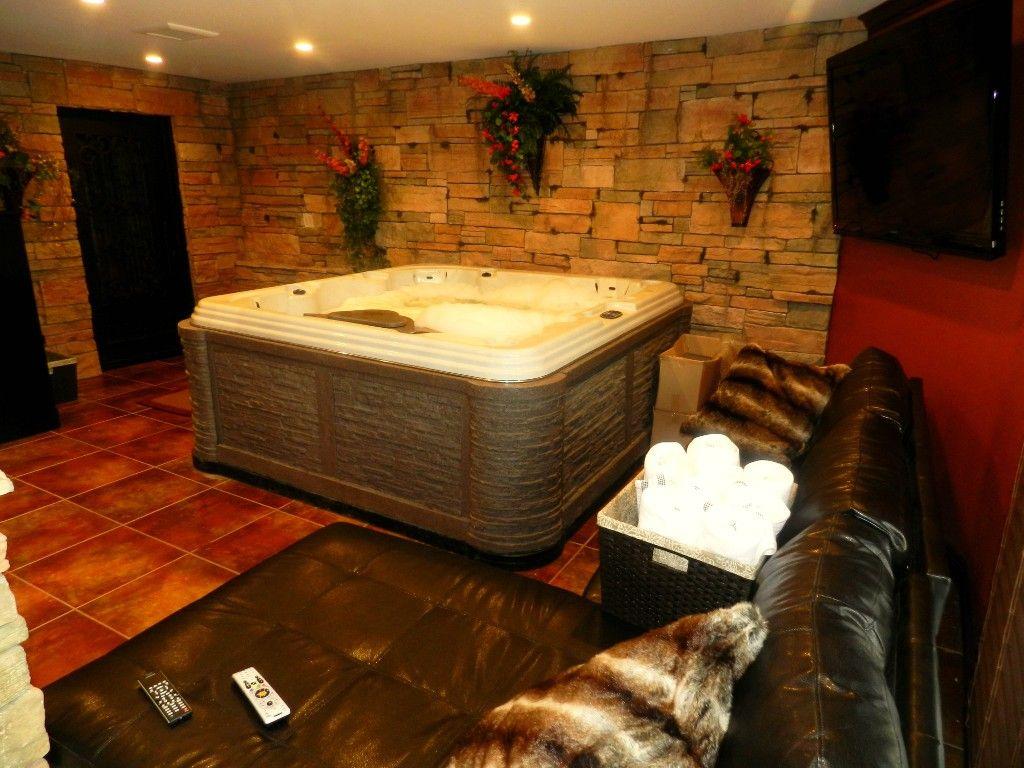 indoor jacuzzi room w 60 inch led t v on wall and wine. Black Bedroom Furniture Sets. Home Design Ideas