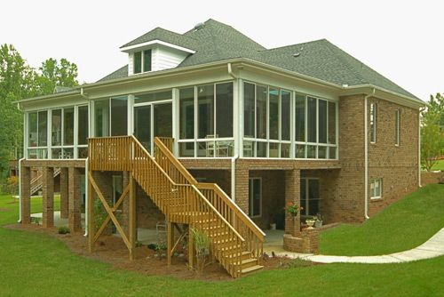 Outside View Of A Large Sunroom Under Existing Roof As Part Of A Deck