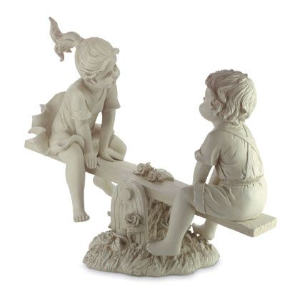 Garden Statue Boy and Girl On See Saw Bring a little whimsy to