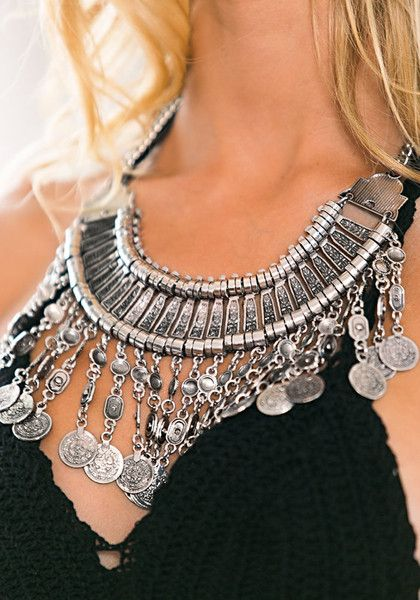 This statement-making silver necklace will breathe new life to your boring tees or plain strapless dresses.