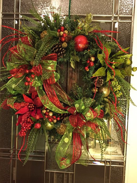 good - Christmas Red and Bright Green Poinsettia Glitter Wreath  If you're going to go all out, go all out.  Embrace the artificial?