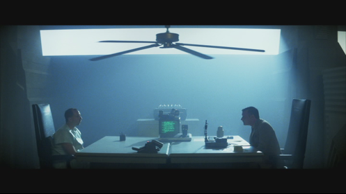Holden, a blade runner, gives a VK test to the replicant Leon inside the Tyrell…