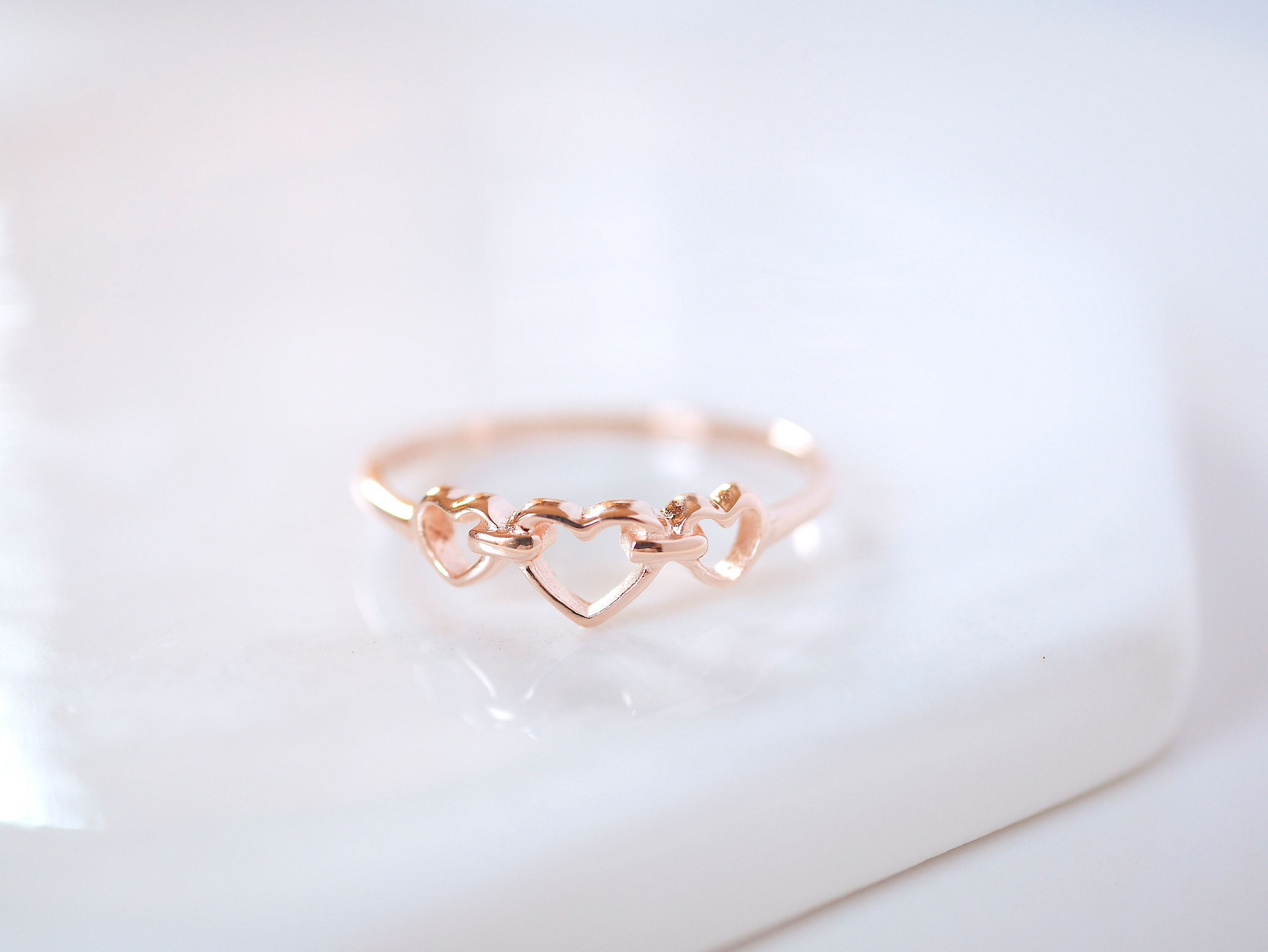 This little dainty ring is crafted in a remarkable heart shape knotted together. It also represents a symbol of undying love. It makes a perfect Valentine's gift and jewelry, but you can enjoy wearing it every day still. This meaningful heart ring is a timeless treasure that offers a comfortable fit without compromising style. This ring: - available in 2 base metal options, sterling silver and solid golds from 10K, 14K, and 18K - sterling silver base comes with 3 finishes: silver, 14k gold plate