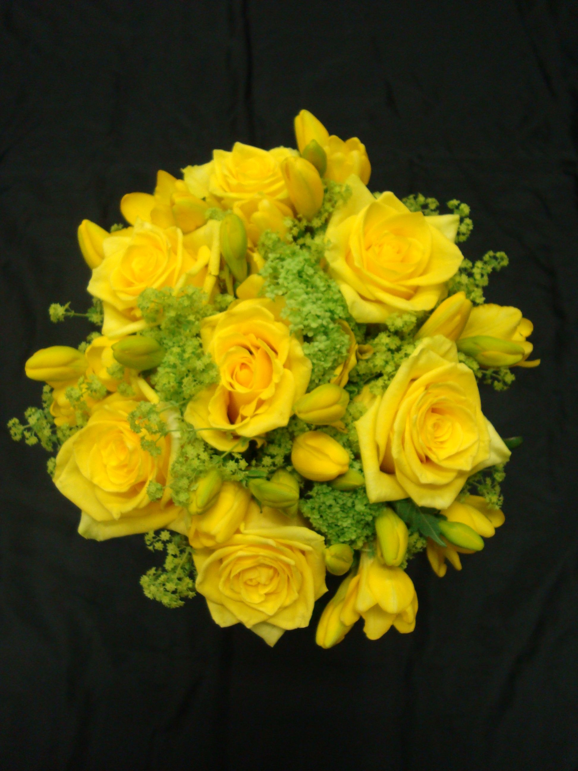 Yellow rose and freesia bridesmaids bouquet
