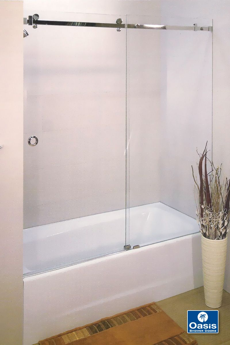 The Oasis Lucente Frameless By Pass Door Features A Fixed Panel Industrial Low Profile Sliding T Shower Doors Sliding Shower Door Semi Frameless Shower Doors