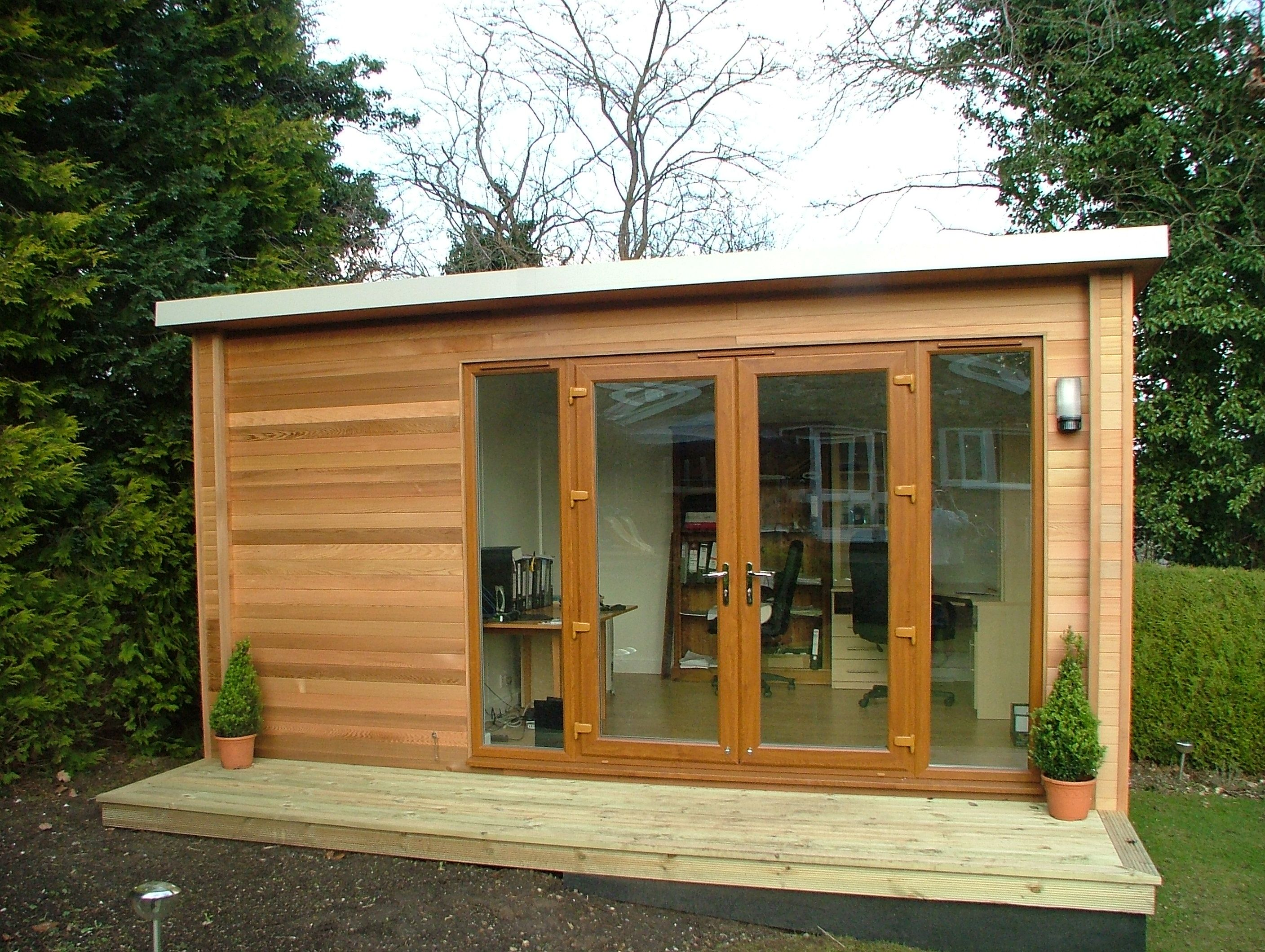 Home garden office with a flat roof and upvc french doors for Cedar garden office