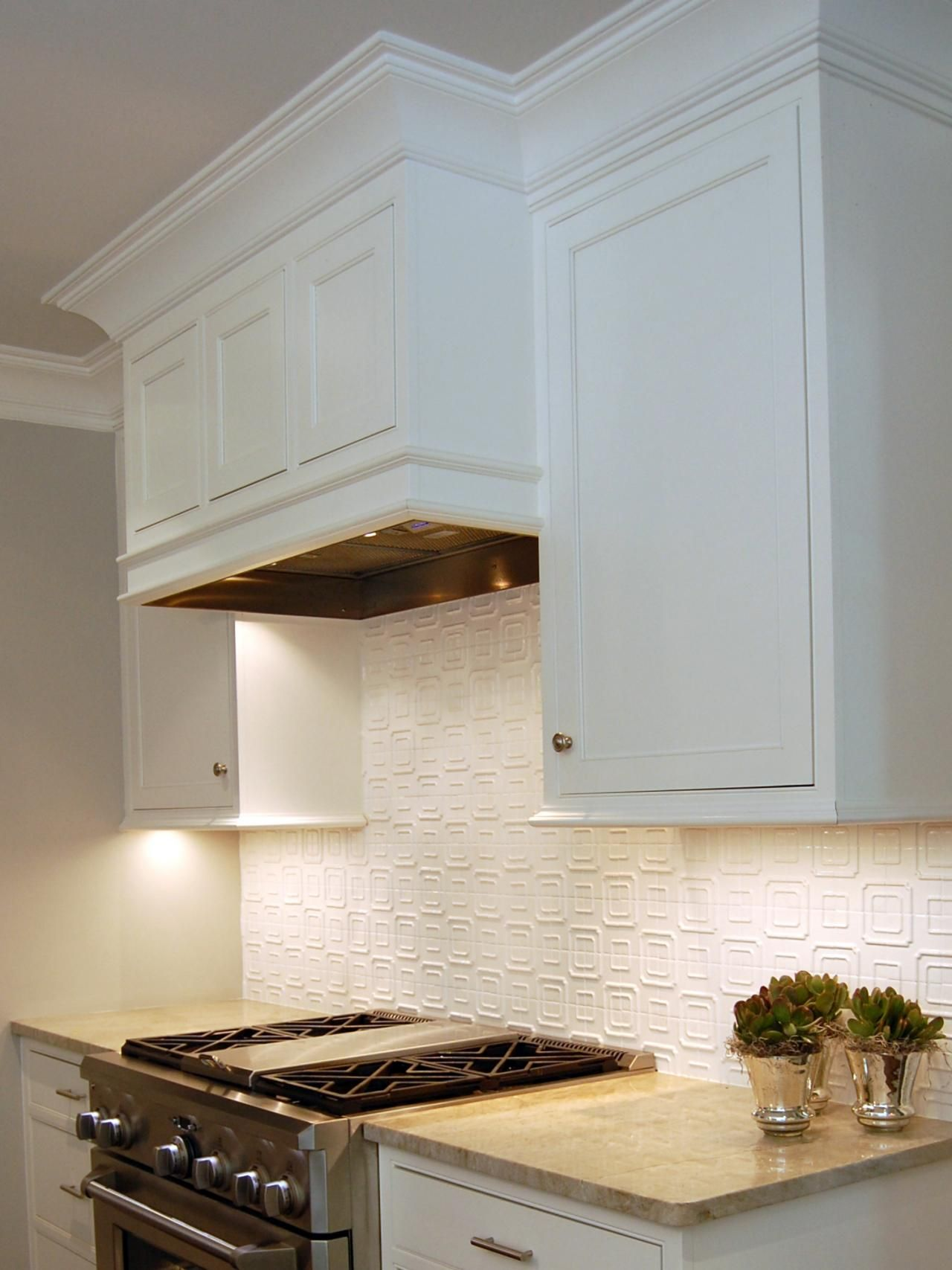 The hidden range hood helps the open kitchen blend easily for Vent hoods for kitchens