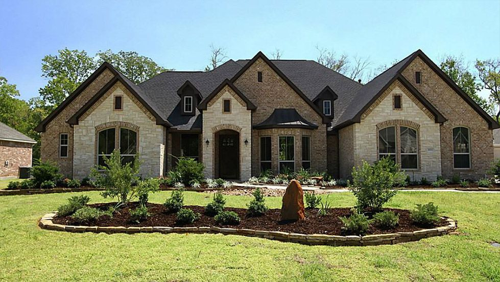Brick and stone combinations brick stone or stucco for Luxury brick house plans