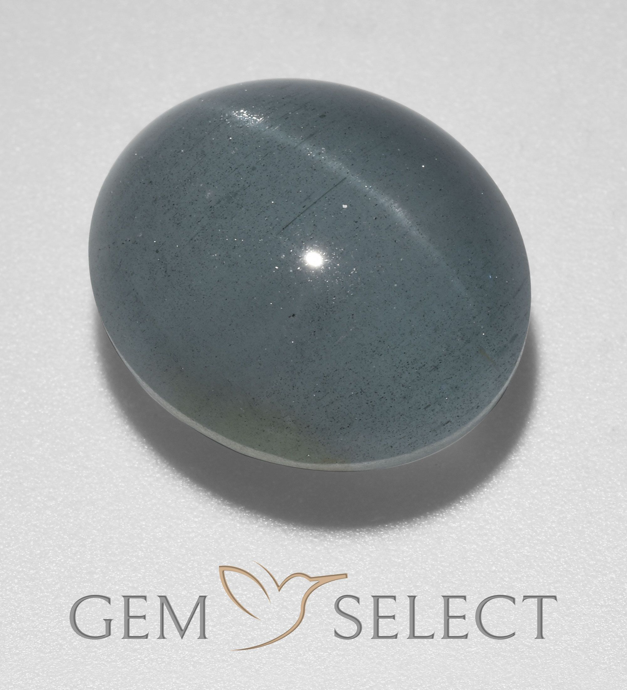Oval Cabochon Blue Cats Eye Aquamarine from India GemSelect features this natural untreated Cats Eye Aquamarine from India This Blue Cats Eye Aquamarine weighs 437ct and...