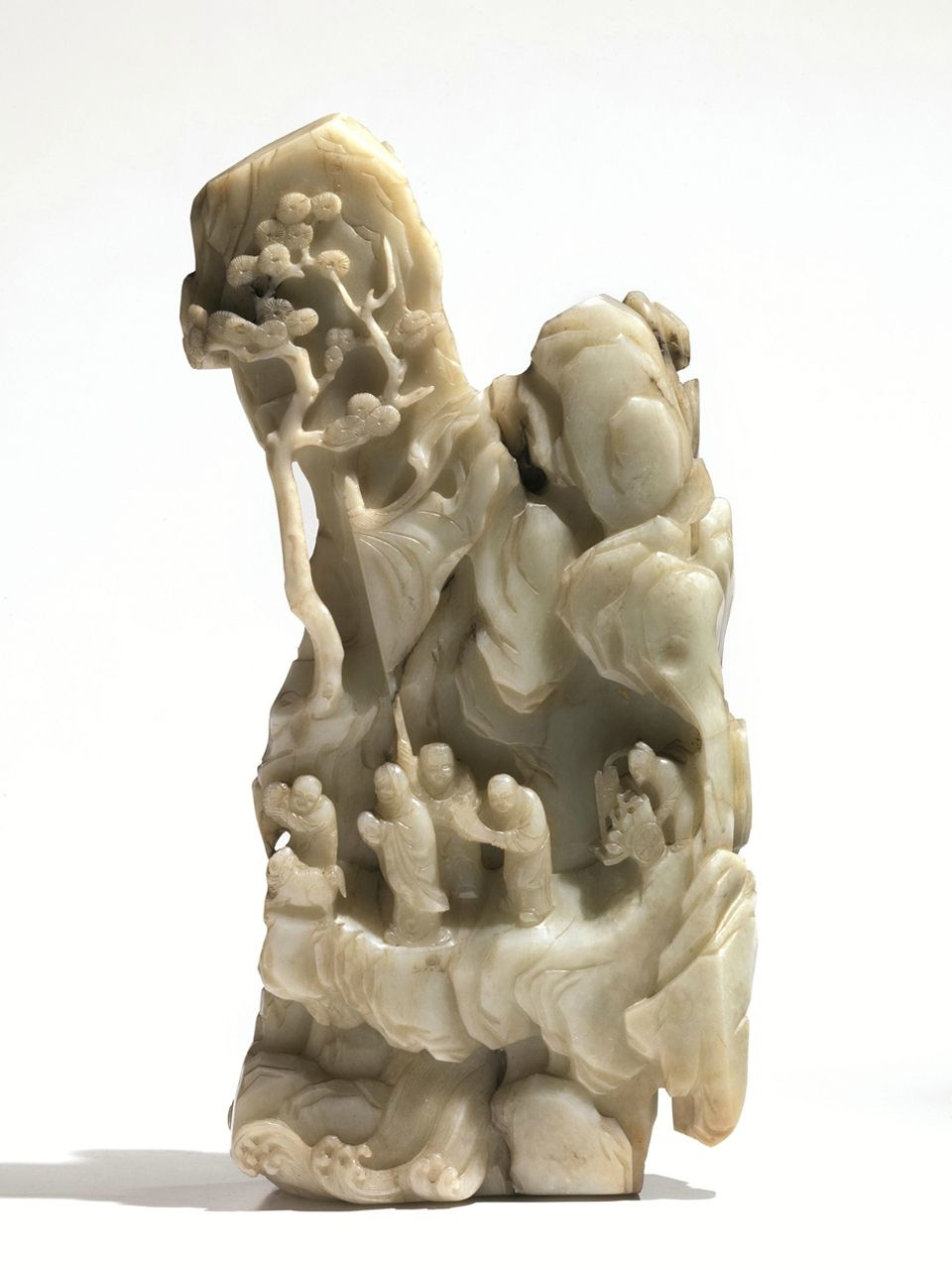 A finely carved pale green jade in the shape of a mountain with trees and figures, China, Qing dynasty, 18th century. 27 cm (10 3/5 in.). BRUN FINE ART, Dealer.