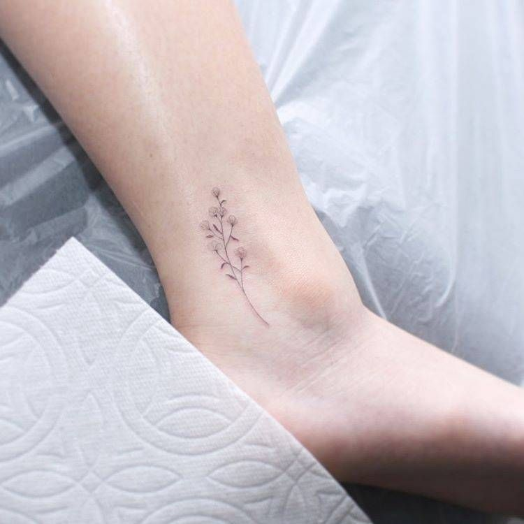 Small Grass Flower Tattoo On The Ankle Dainty Tattoos Tattoos Flower Tattoo On Ankle