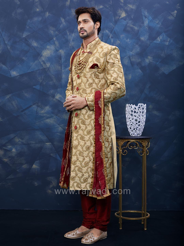 Miraculous golden color art silk sherwani bride n groom wardrobe