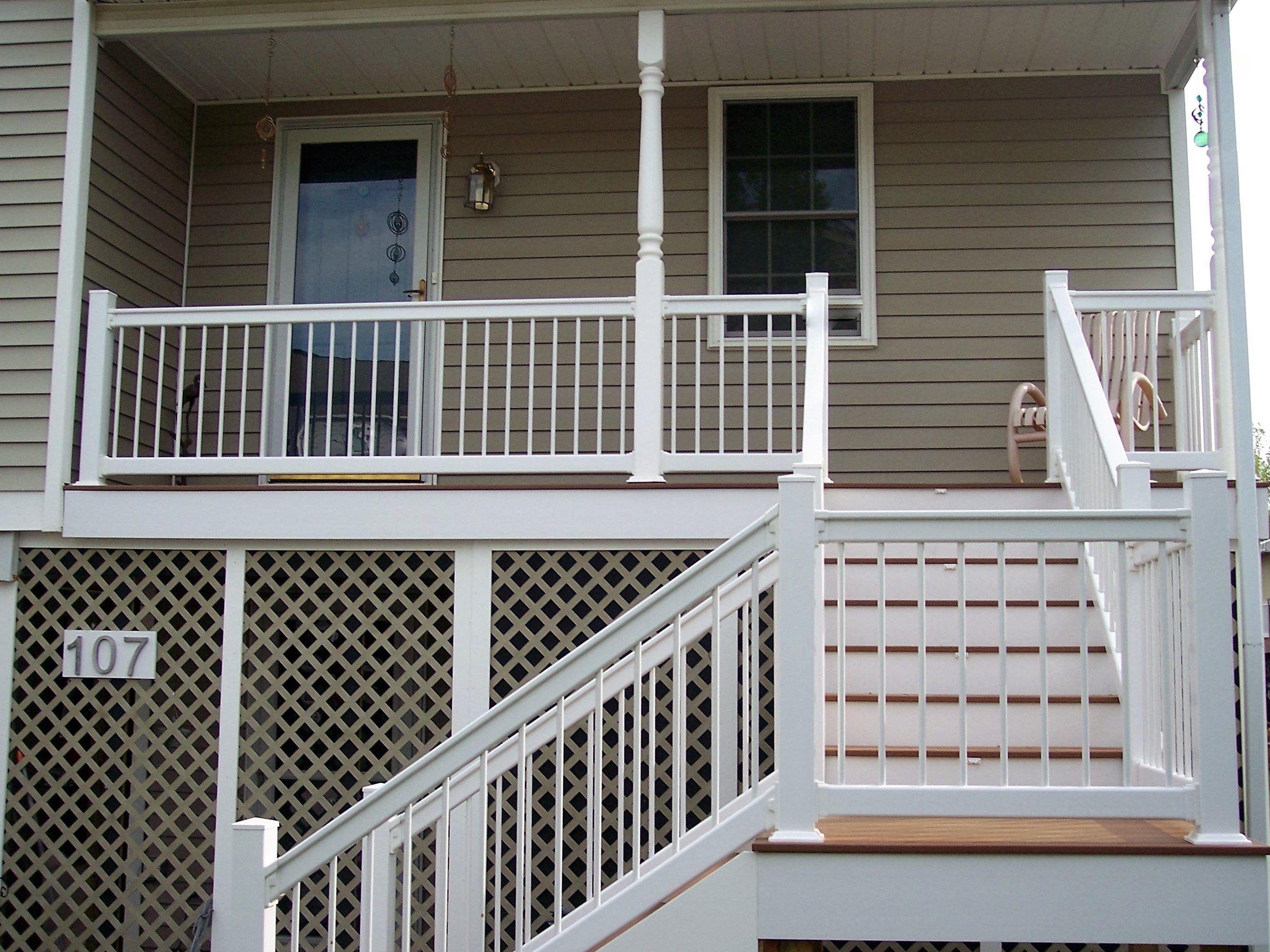 Fiberon Ipe decking with white vinyl rails | Vinyl railing ...
