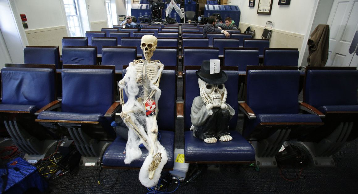 Journalistic Halloween decorations sit in the briefing room of the