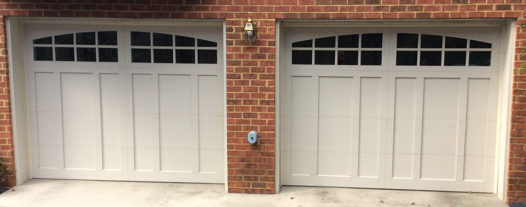 Two 9x7 Model 5632a Almond Garage Doors With Arched Stockton Glass Installed By The Richmond Store House Exterior Garage Doors Doors