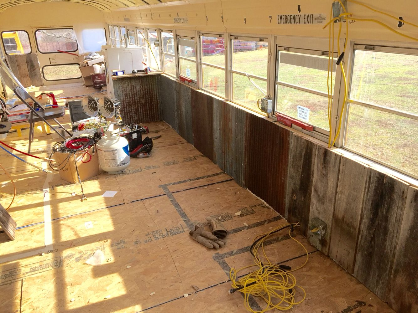 reclaimed barn wood and tin walls tiny house bus