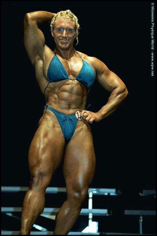 Female Bodybuilder Showing Her Powerful Thick Muscles