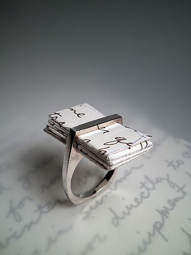 Bound a love note in a ring. Loves this