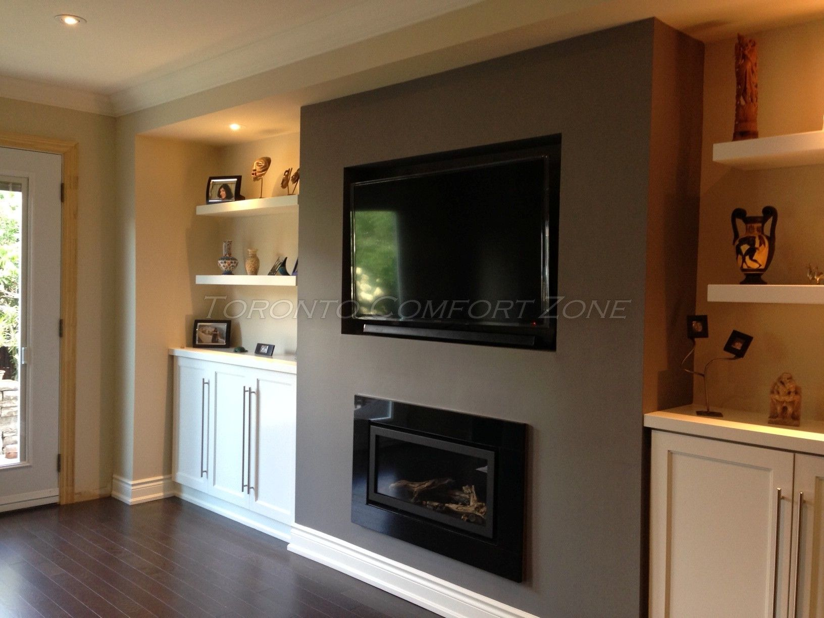A Linear Gas Fireplace With Cabinets And Floating Shelves
