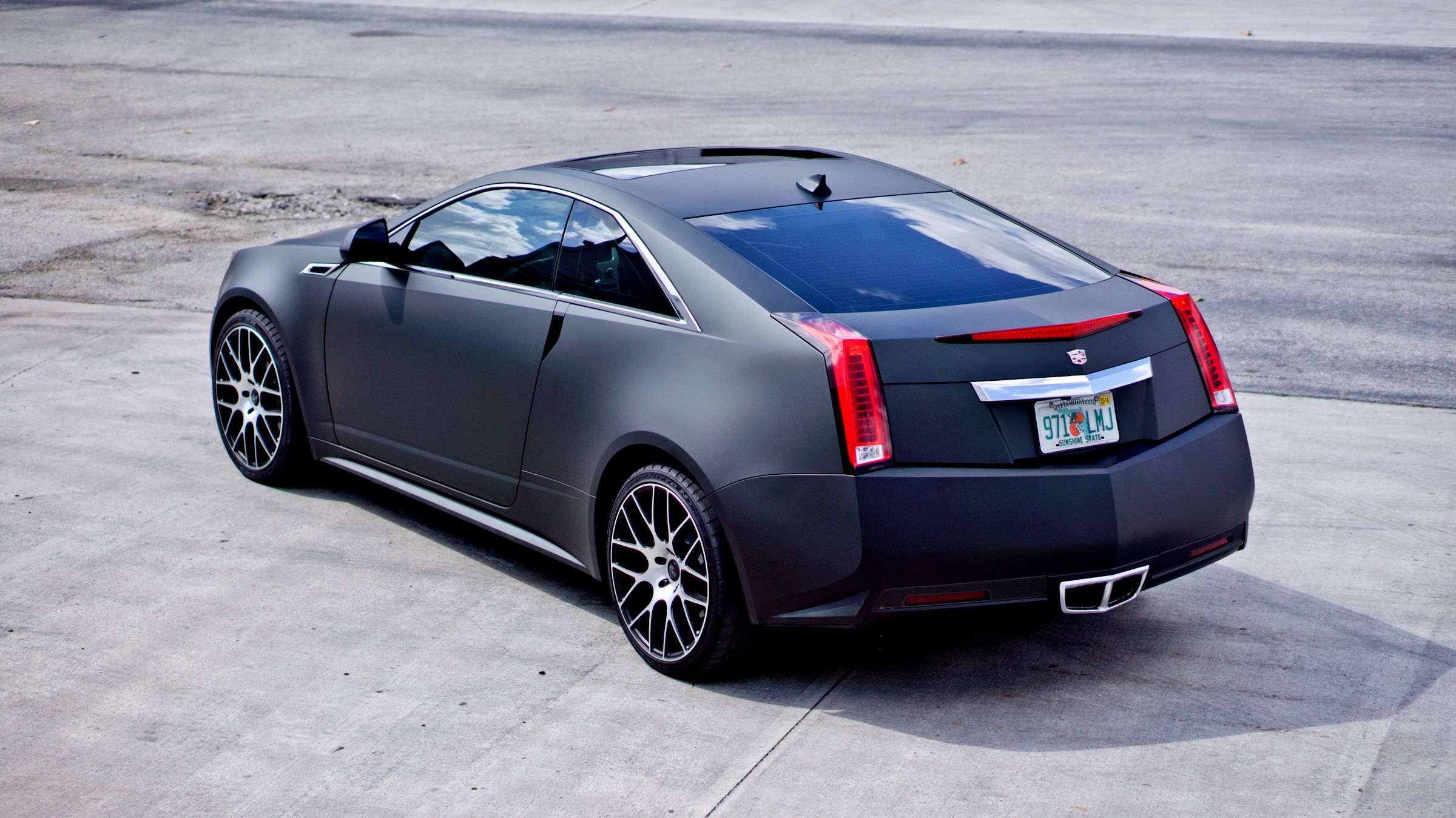 Cadillac cts miami matte black vinyl wrapped car by 3m preferred certified car wrap solutions