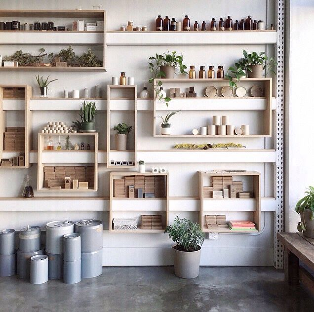light, simple display wall | coffee shelf | Store design ...