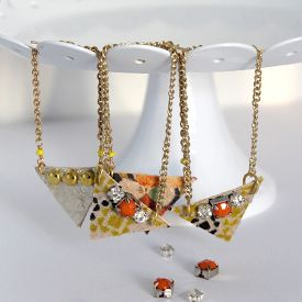 Gorgeous leather earrings backed with printed fabric and added studs and jewels
