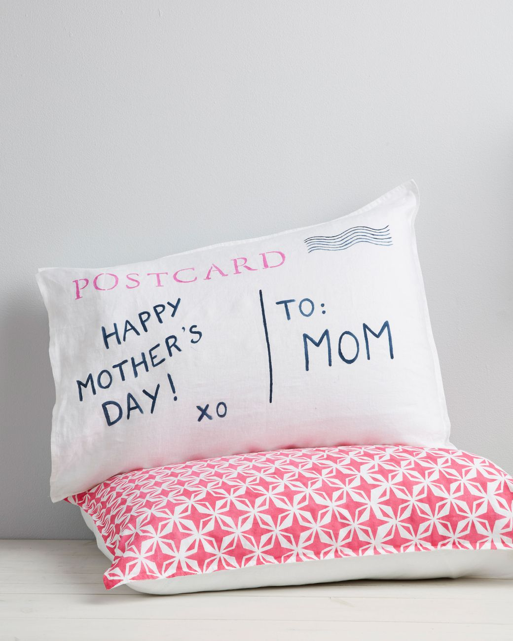 Living long distance from Mom? This Mother's Day, send her your love with a DIY pillow in the shape of a vintage postcard (stamped with a personalized message specially meant for her).