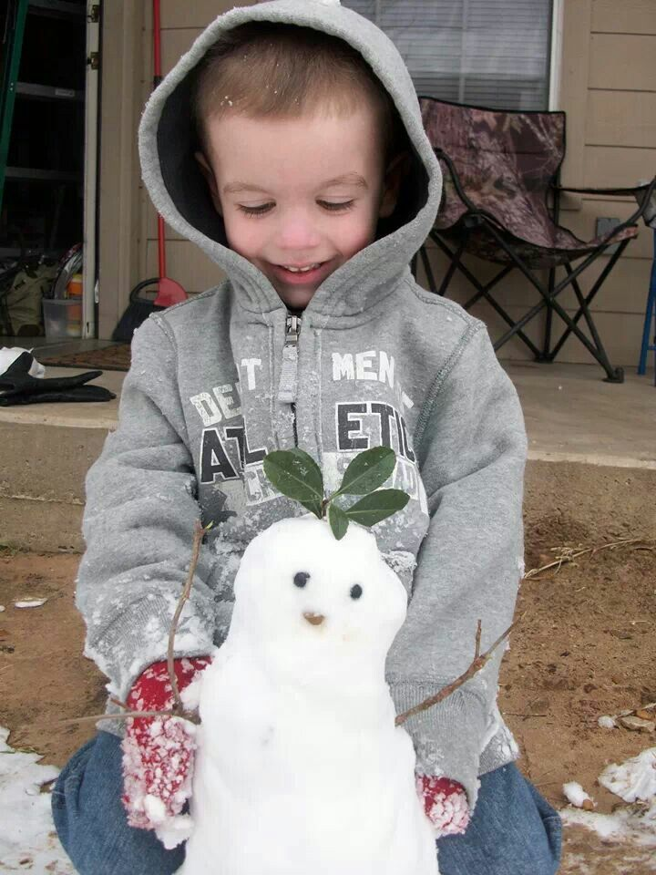 Built his first snow man by himself