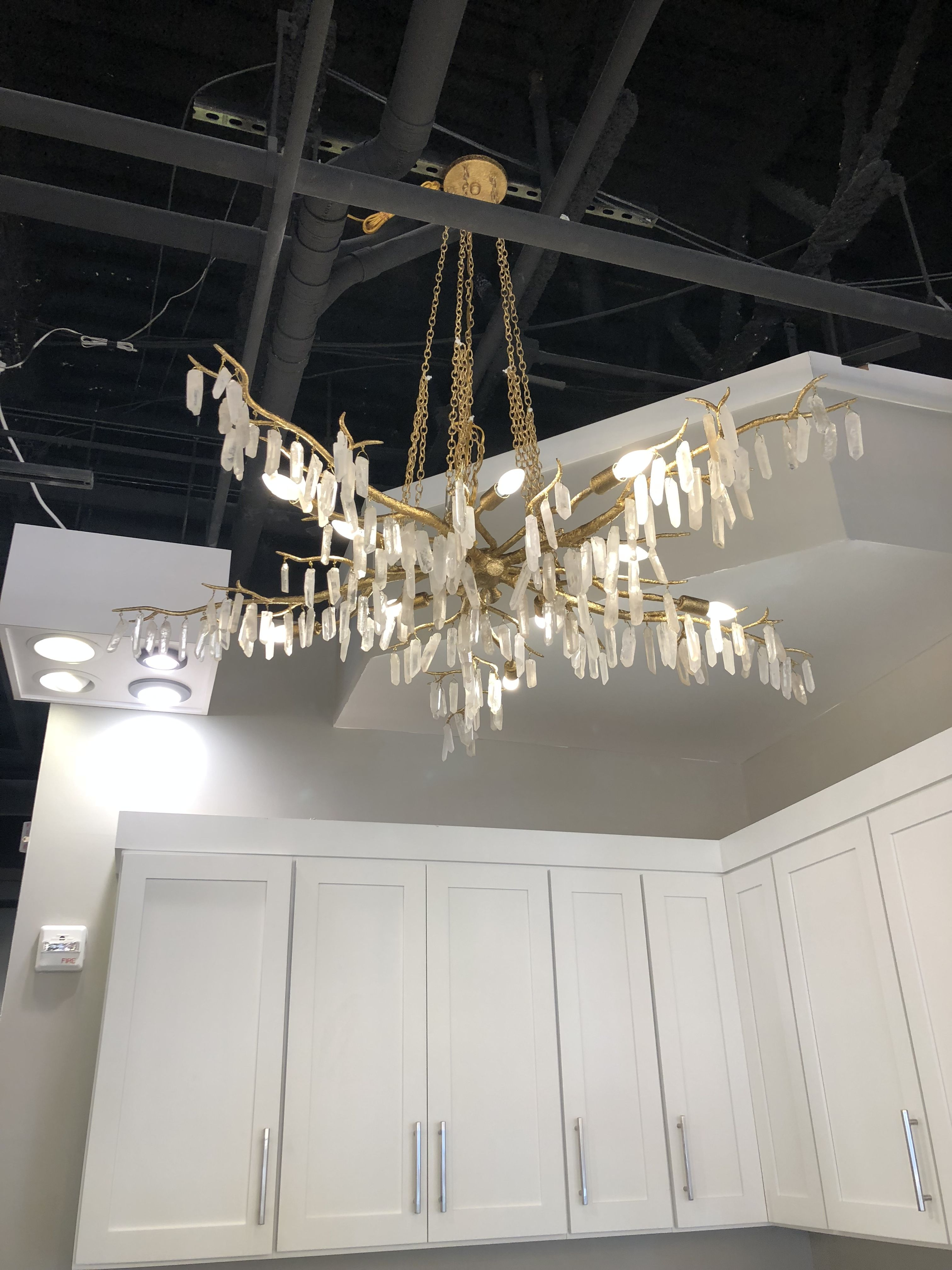 Look at this gorgeous forest light chandelier featured in downtown greenvilles sc design on tap made by currey m obsessed with its beauty