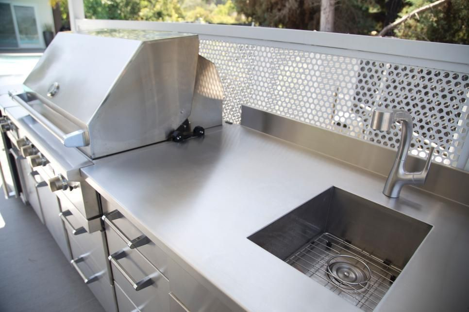 This Sleek Outdoor Kitchen Features A Stainless Steel Countertop