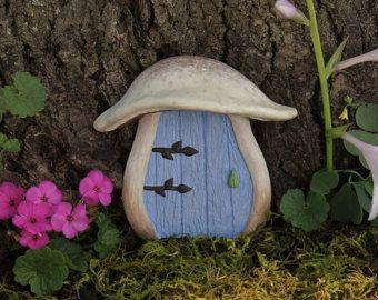 A cute mushroom fairy door for your garden! The mushroom top keeps wee folk dry from the rain - what fairy could resist! A Jul McFillin