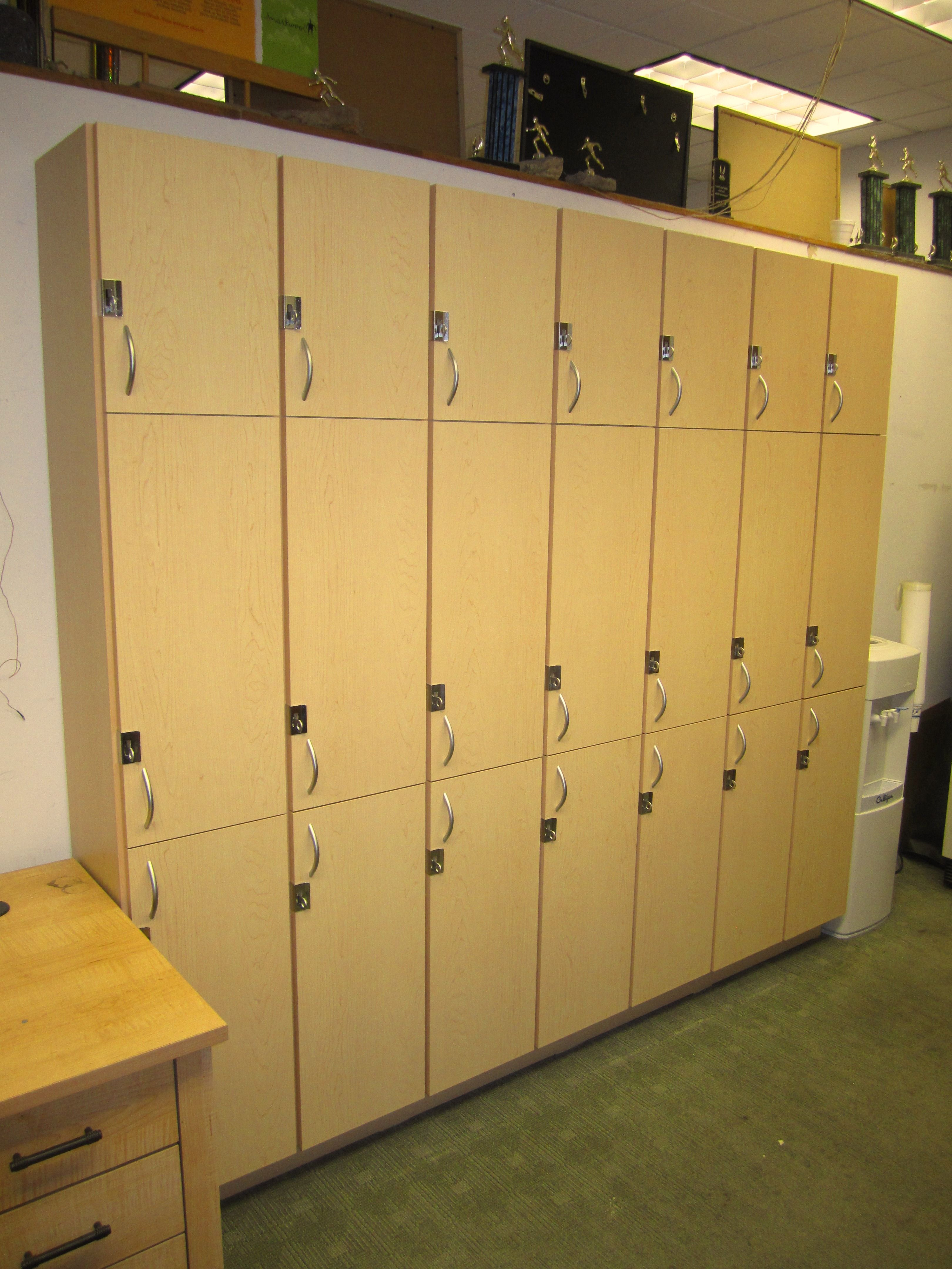 Custom Employee Lockers Designed And Installed For A Local Running Store.  Learn More At Www.closetsforlife.com.