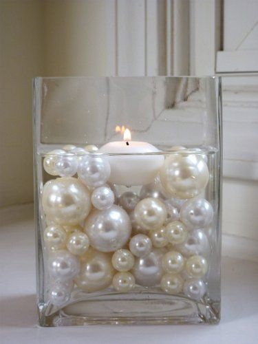 Pearls with floating candles  ... for a bridal shower ... pretty!