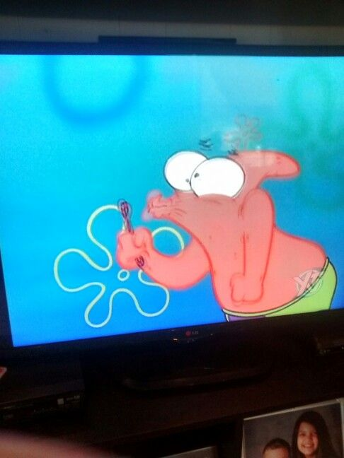 Patrick atempting to blow a bubble