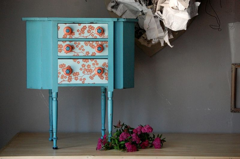 I like the idea of wallpapered drawers!