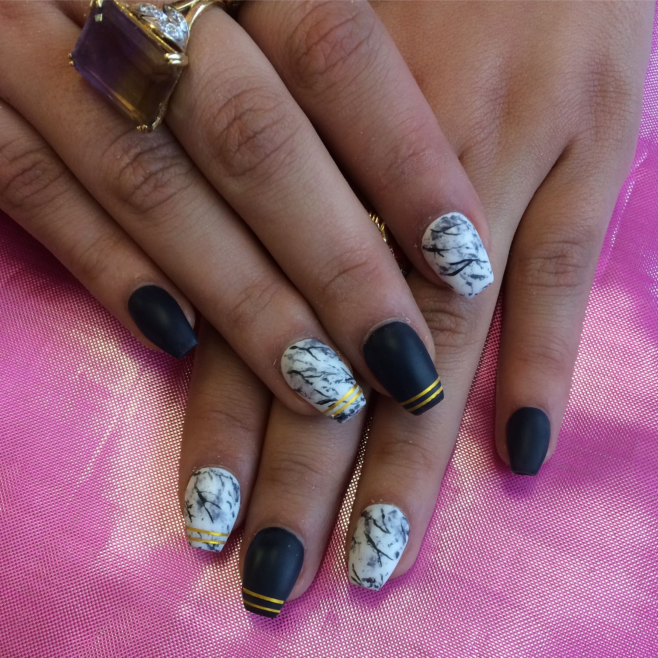 Matte Marble Nail Art With Deep Navy Blue And Gold Stripe Details On