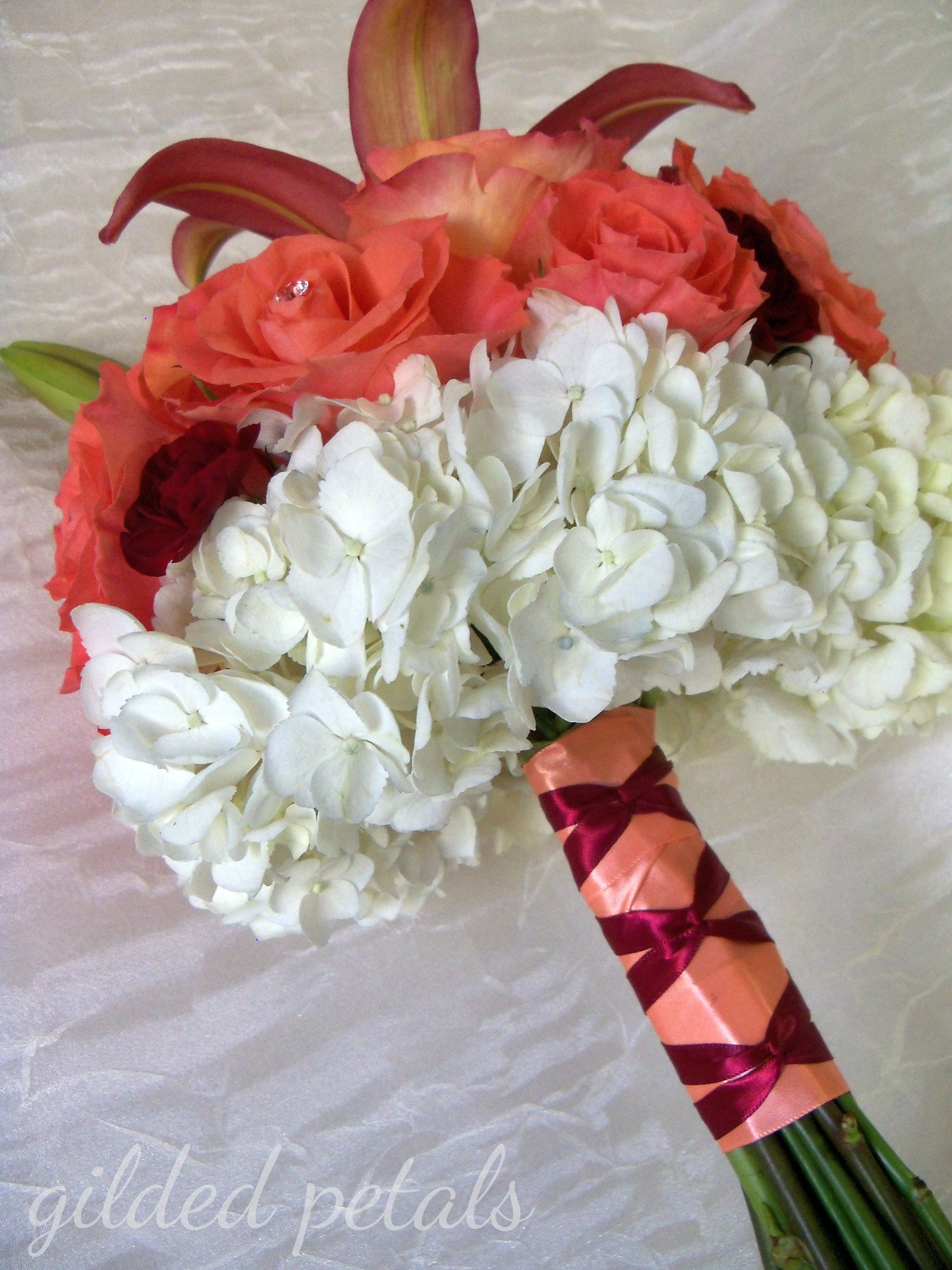 cascading bridal bouquets with burgandy, coral and white